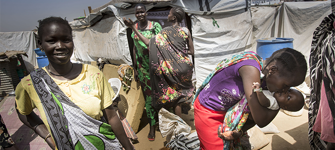 A family in front of their tent at the UN House compound in Juba, South Sudan. Photo: Oxfam/Petterik Wiggers