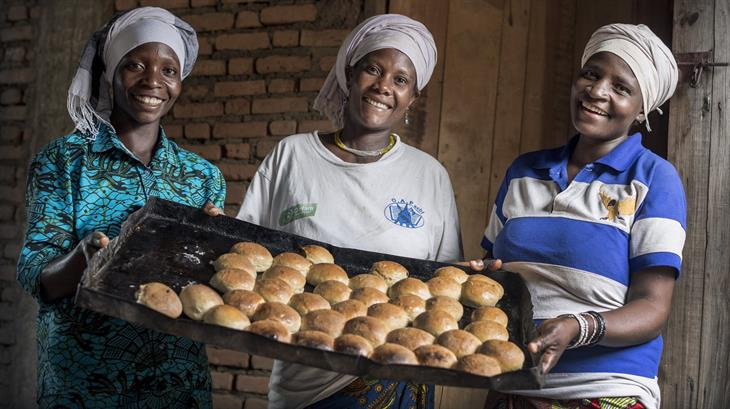 Esperance, Agripina and another baker from the Women's Union of Gitaza with some of the bread they baked.