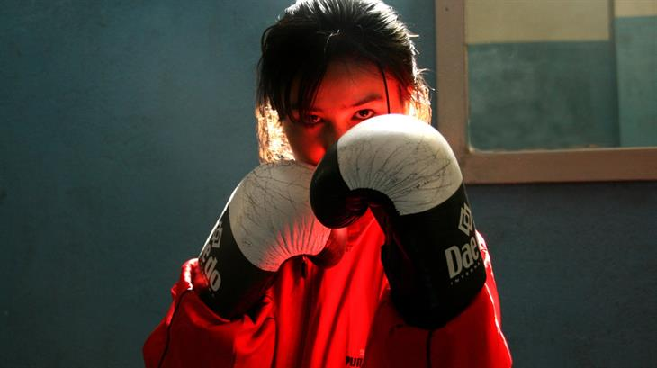 A girl training in the gym at The National Stadium in Kabul.