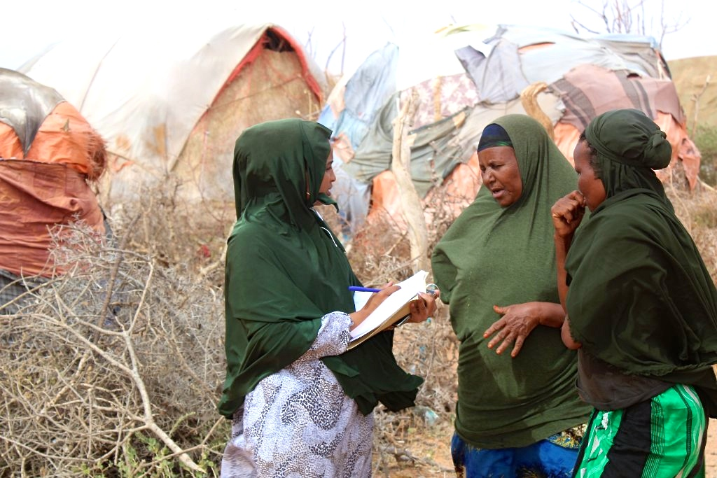 Hamda Mohamed is registering which vulnerable people are eligible to receive a hygiene kit in the village of Habariheshay in the Sool region – A.jpg